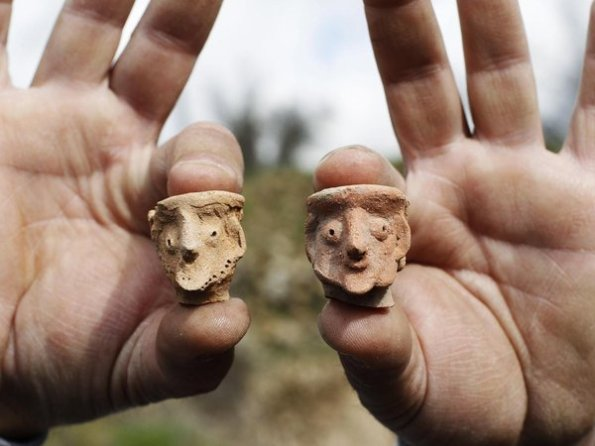 Baz Ratner / ReutersAn employee of the Israeli Antiquities Authority displays figurines at Tel Motza archaeological site on the outskirts of Jerusalem.